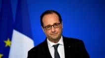 France/présidentielle: Hollande adoube Macron à Bruxelles pour faire barrage à Marine Le Pen