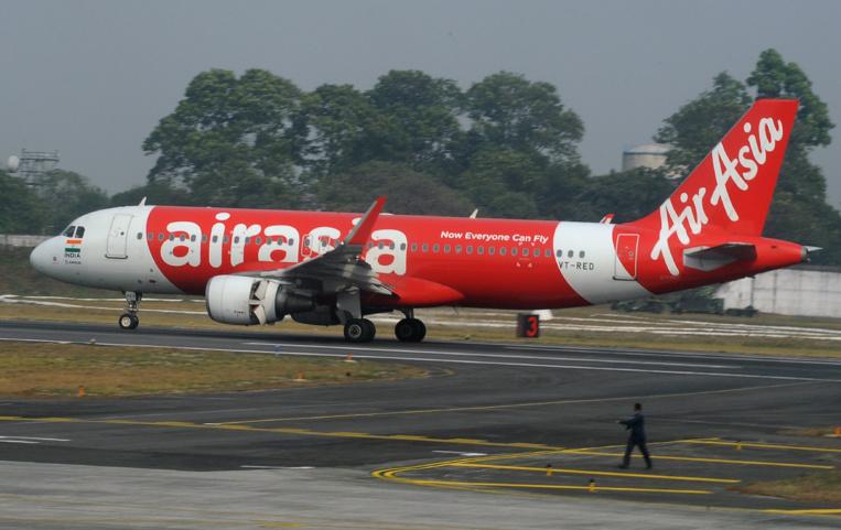 """""""Secoué comme une machine à laver"""", un vol d'AirAsia retourne en Australie"""