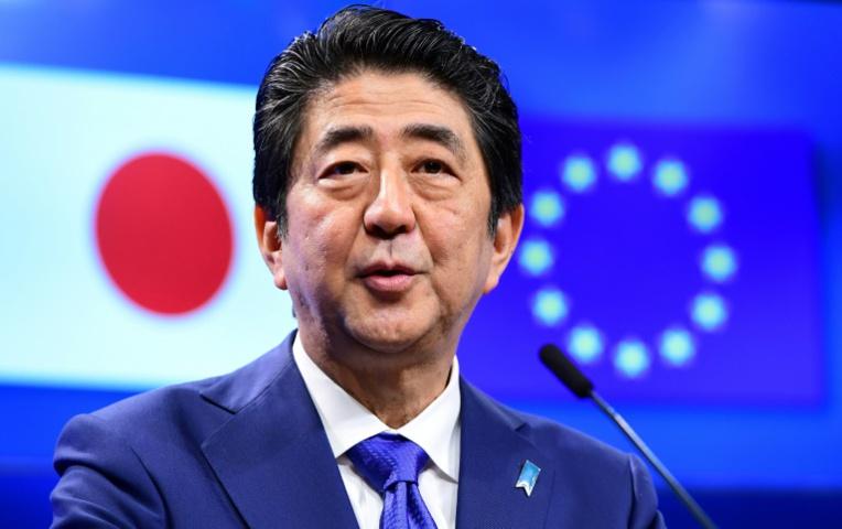 Le premier ministre japonais était à Bruxelles en mars dernier (© AFP | EMMANUEL DUNAND)