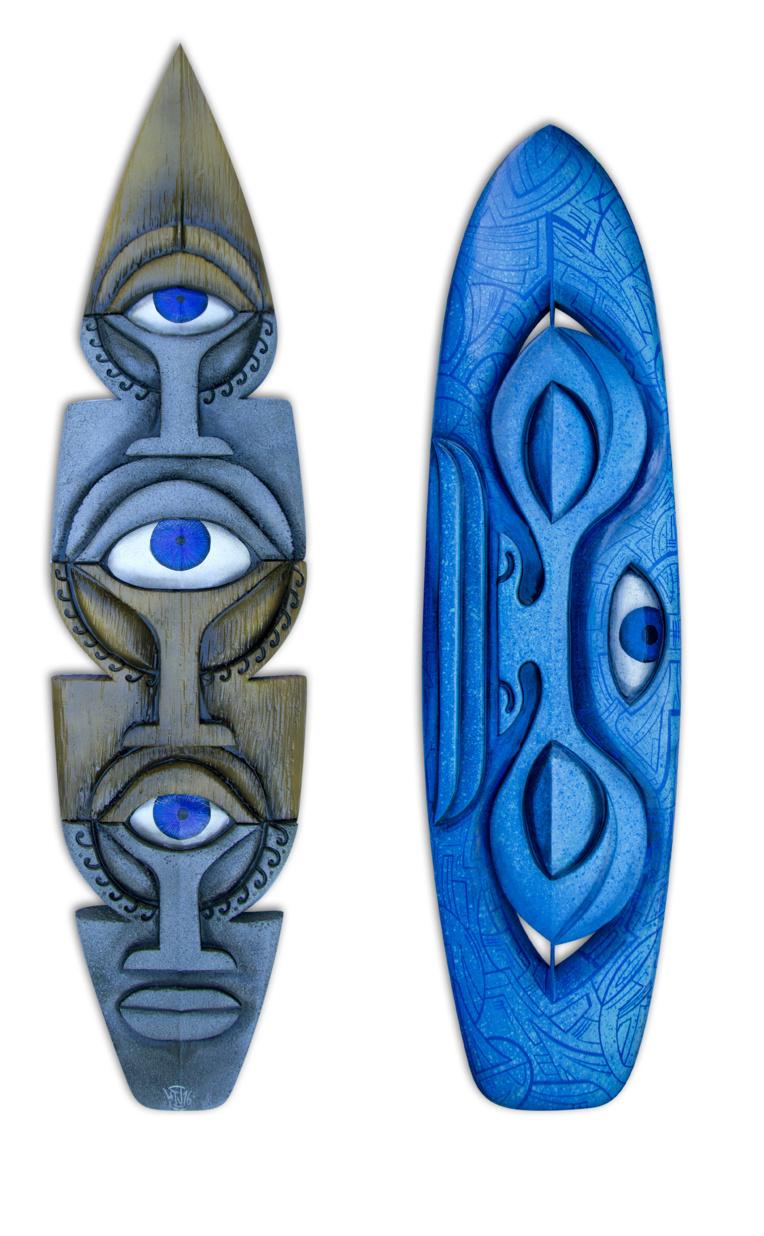 """Les planches de surf sculptés et peintes sont devenues sa """"marque de fabrique"""", elles ont fait sa réputation."""