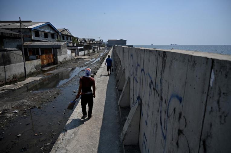 """Bientôt """"ancienne"""" capitale, Jakarta s'enfonce sous les eaux"""