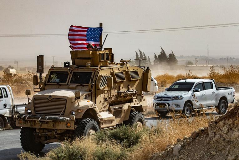 """La Turquie """"prête"""" pour une opération en Syrie malgré les menaces de Trump"""