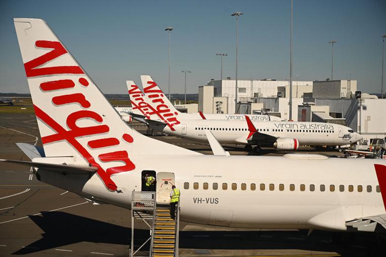 Coronavirus: la compagnie aérienne Virgin Australia ferme une filiale, supprime 3.000 postes