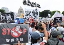 Le Japon adopte des lois de défense controversées
