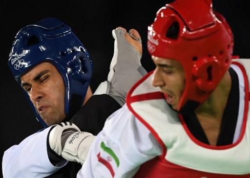 Pita Taufatofua face à Sajjad Mardani. image : Kirill Kudryavtsev/AFP Photo