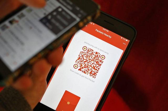 """Nouvel an: 46 milliards """"d'enveloppes rouges"""" électroniques échangées en Chine"""