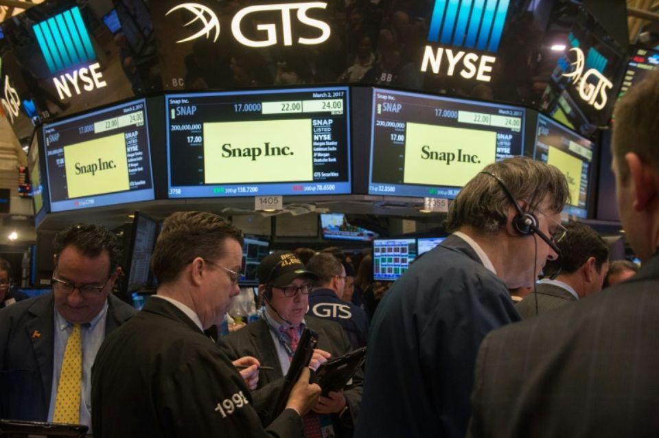 Les traders à Wall Street au cours de l'introduction en Bourse de Snap Photo Bryan R. Smith. AFP