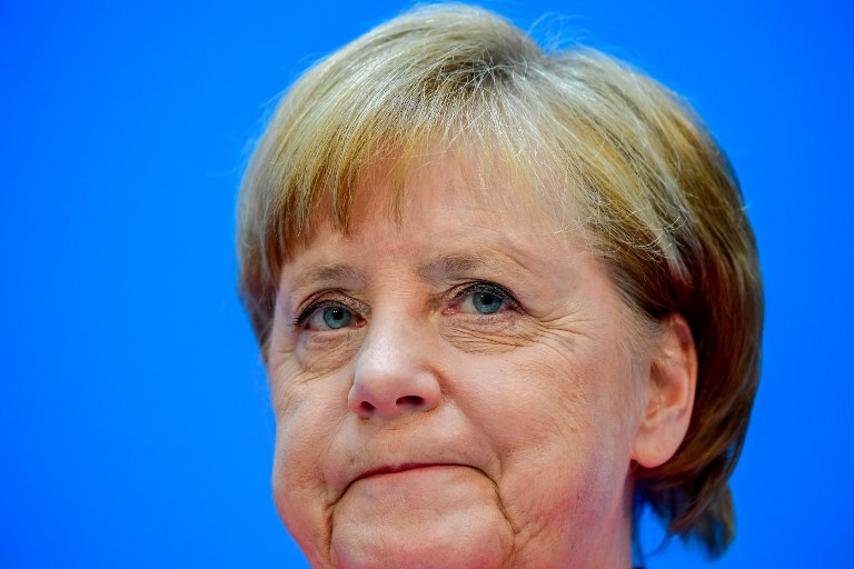Migrants: Merkel menacée par sa droite et Donald Trump