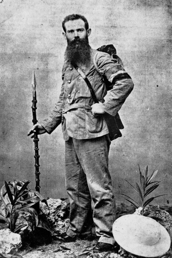 Henri Gilbert tel qu'il se fit photographier peu après son départ pour un tour du monde à pied. Le jeune journaliste était âgé de 29 ans.
