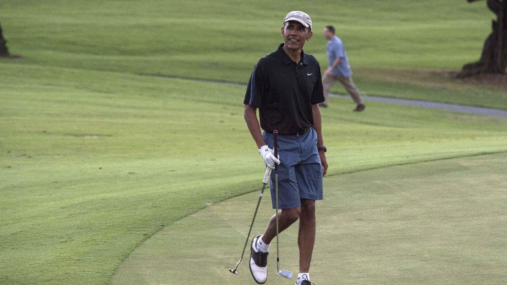 Le président américain Barack Obama sur le parcours de golf de Kailua, à Hawaï (Etats-Unis), le 30 décembre 2014. (NICHOLAS KAMM / AFP)