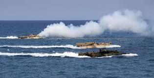 """Kerry dénonce la """"militarisation"""" de Pékin en mer de Chine méridionale"""