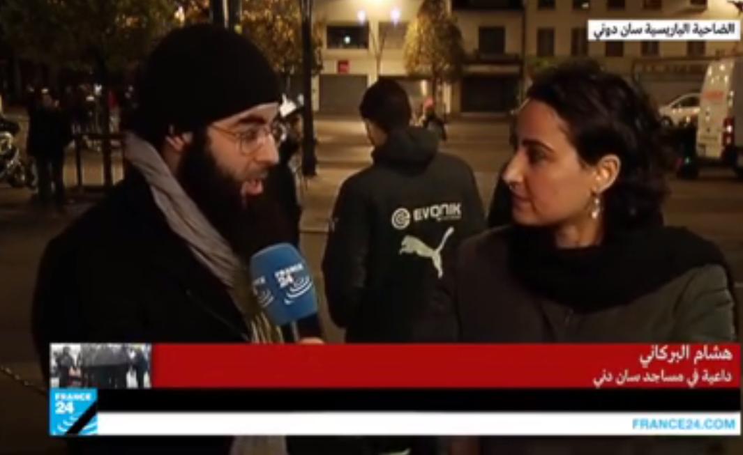 Hicham El Barkani, au micro des journalistes de France 24. L'imam de Tahiti logeait à proximité de l'immeuble de Saint-Denis pris d'assaut par le Raid mercredi.