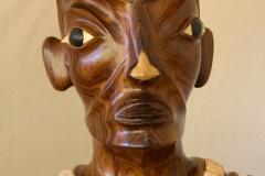 Tiki en bois de tou et en os de bœuf sculpté et poli